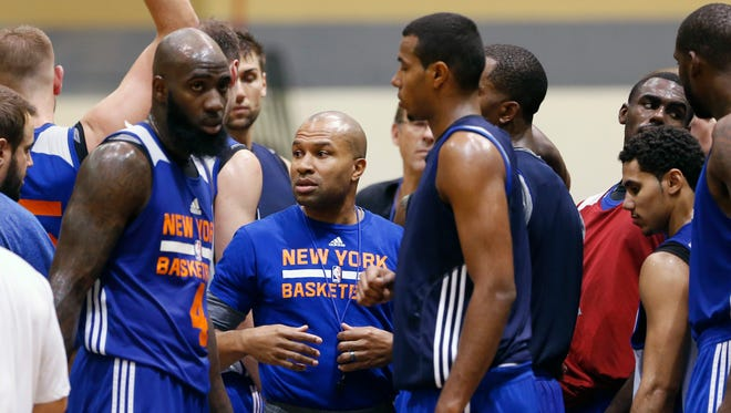 Knicks basketball  coach Derek Fisher talks to players during practice at the team's training camp at West Point on Tuesday.