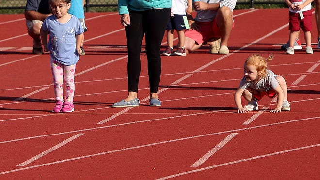 Maelie Riordan, 3, of Marshfield gets in position for the start of the 50-meter dash.