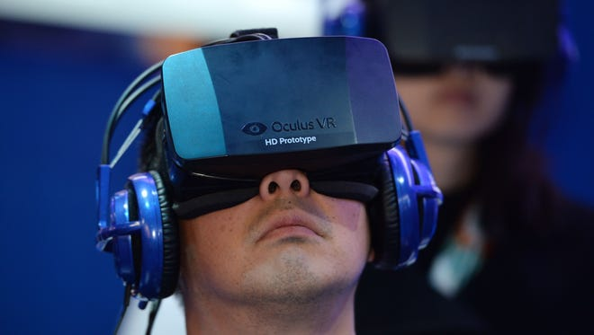 A CES attendee wears an Oculus Rift HD virtual reality head-mounted display as he plays EVE: Valkyrie, a multi-player virtual reality shooter game, at the Intel booth at the 2014 International CES in January.