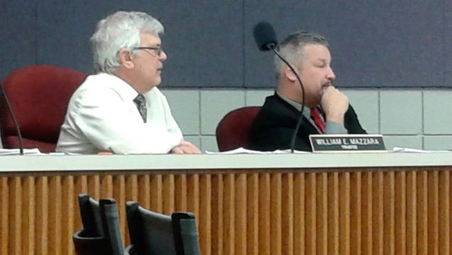 Milford Township trustees William Mazzara and Brien Worrell listen to a presentation about Battery Solutions.