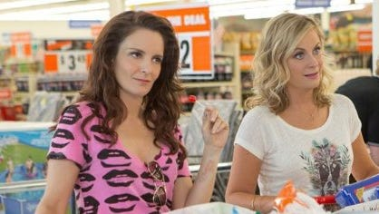 """Tina Fey as Jane Jones and Amy Poehler as Maura Ellis in a scene from the upcoming comedy """"Sisters."""""""