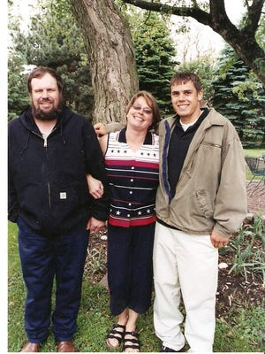 Dave and Joan Becker are show with their son, Mark, at his high school graduation reception in 2004. Mark is currently serving a life sentence for the fatal shooting of Coach Ed Thomas.