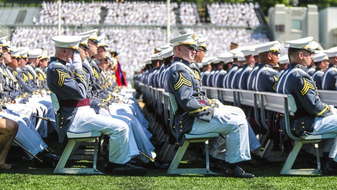 A cadet wipes the sweat from his brow during the 220th graduation and commissioning ceremony at the U.S. Military Academy at West Point on Saturday, May 26, 2018.
