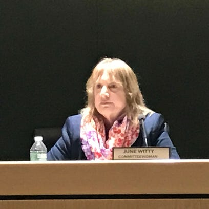 Montville Committeewoman June Witty listens to critics