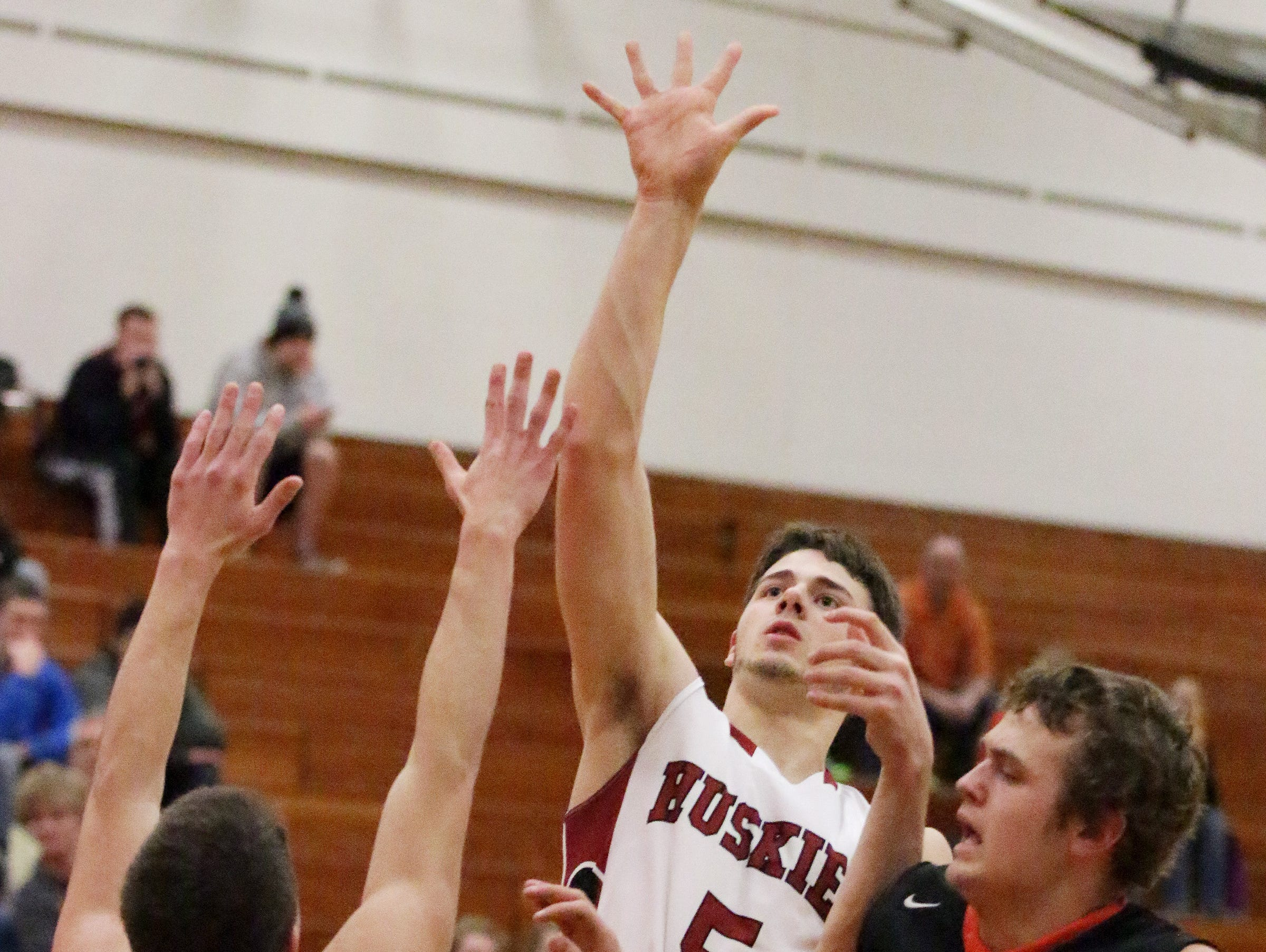 New Holstein's Josh Burg (5) averaged 16.5 points and 6 rebounds per game last season for the Huskies.