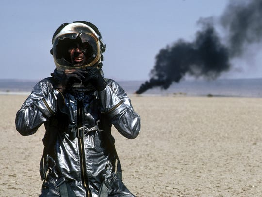 Sam Shepard as Chuck Yeager, wearing flight suit and