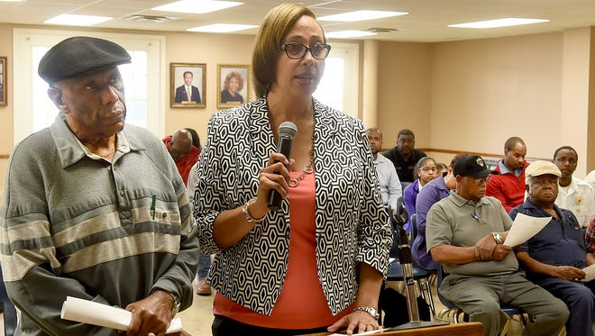 Wilbert Stout and Lisa Duffey addresses Opelousas Board of Aldermen concerning the demolition of the Charcoal Lounge.