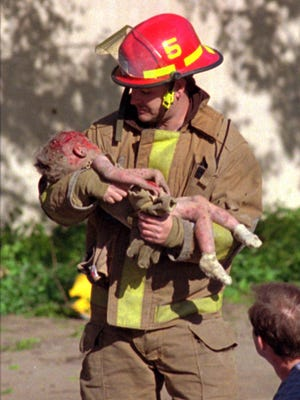 Oklahoma City fire Capt. Chris Fields carries 1-year-old Baylee Almon away from the aftermath of the April 19, 1995, bombing that killed 168 people.