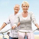 A happy mature couple setting off on their daily bike ride