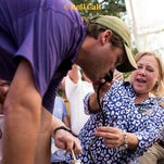 Sen. Mary Landrieu helps with a keg stand before Saturday's LSU game.