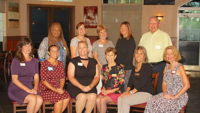 The Community Action Grants committee of the Port St. Lucie Business Women recently presented awards totaling $8,000 to nine Treasure Coast non-profit organizations that benefit women and children. Pictured are, front row: Tracy Levy, Safespace; Christine Ionatti, HANDS of St. Lucie County; Mary Craig, Council on Aging of St. Lucie; LuzMa Camacho, Learn to Read of St. Lucie County; Laura Klosterman, Grace Packs Inc. Back row: Charmayne Davis, Inner Truth Project; Julia Summers, Sarah's Kitchen; PSL Business Women Community Action Grant committee co-chairs Lori Coyle and Terri Larrivee-Schulte; and Dr. Andrew J. Passeri, HANDS of St. Lucie County.