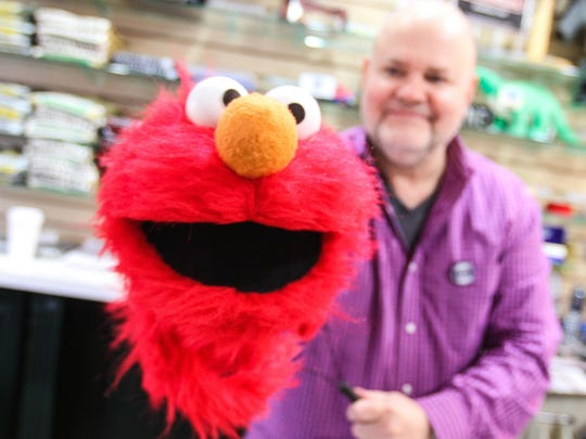Bobby Tullock, of Bobby's News & Gifts, will have Elmo and Santa visiting his shop for Small Business Saturday on Main Street in Boonton on November 28, 2015.