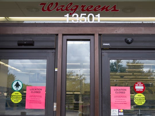 Signs on the doors of the Walgreens advise customers that the location at Hancock Bridge Parkway and US 41 in North Fort Myers is closed.