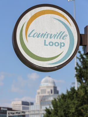 The Louisville Loop is marked by these circular signs.