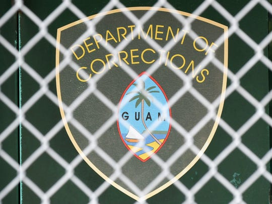 Department of Corections logo on the Hagåtña lockup entrance.