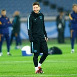FC Barcelona's Lionel Messi smiles during a practice