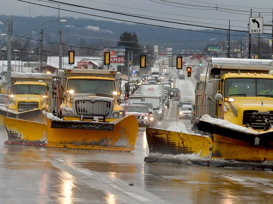 Three PennDOT trucks work side by side going westbound on Rt. 30 on Saturday, Dec. 17, 2016.