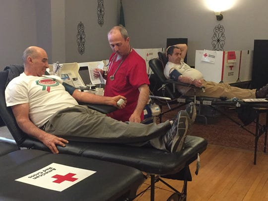 Vince Murray, of Hopewell Junction, donates blood during a previous Red Cross blood drive in memory of Det. John Falcone. Assisting is Red Cross Donor Specialist Patrick Canavan.
