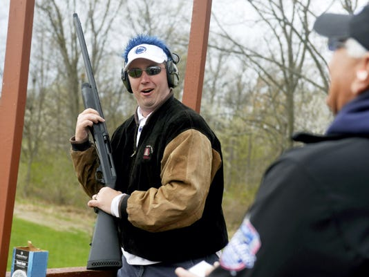 """Matt Shorb of the York Traditions Bank team jokes around between his shots during Penn State York's seventh annual clay shoot event Thursday at Central Penn Sporting Clays in Warrington Township. Penn State wrestling coach Cael Sanderson was on hand as a celebrity shooter to help raise funds for Penn State York athletics in a """"beat the coach"""" competition."""