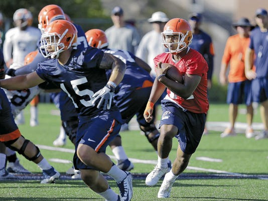 RUBEN R. RAMIREZ—EL PASO TIMES Kavika Johnson, quarterback for the UTEP Miners runs the wildcat during practice Friday morning. Johnson from Las Cruces, N.M. (Mayfield HS) is expected to see  plenty of action this year.