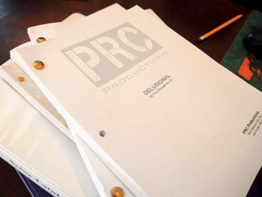 Pictured are various PRC Production scripts.