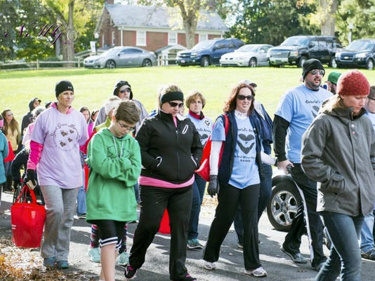 Participants walk together Sunday during the Walk to Remember event in Chambersburg. This year the event raised this year more than 46,000.