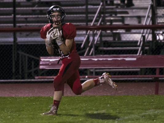 Annville-Cleona's Alec Barr hauls in a touchdown pass on a trick play as Elco defeated Annville-Cleona 40-39 in overtime at Annville-Cleona High School on Thursday, October 1, 2015. Jeremy Long -- GameTimePA.com