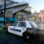 A police car is parked outside of Miguel Contreras Learning Complex on Dec. 15, 2015, in Los Angeles.  All schools in the vast Los Angeles Unified School District, the nation's second largest, have been ordered closed because of a threat.
