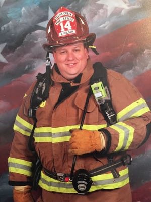 Reems Creek assistant fire chief Johnny Elliott Wilson, 51, died Wednesday.