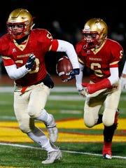 Mount Olive senior linebackerRyan Hodgins gains yardage,