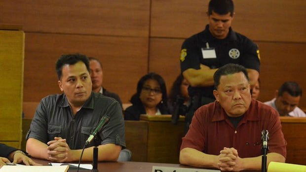 Anthony Quenga, left, and David Manila, listen to the judge at the Superior Court of Guam in the Blue House brothel trial on Thursday, Sept. 19. The two Guam Police Department officers were found guilty on all charges, including rape and kidnapping, although not all counts.