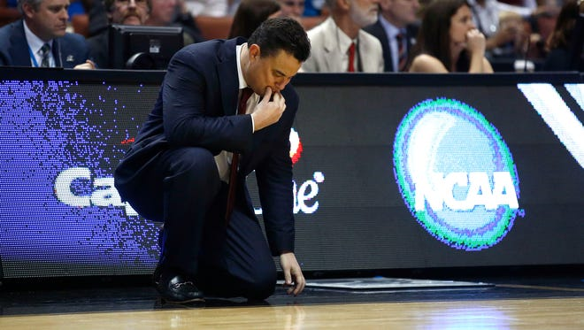 Arizona head coach Sean Miller reacts after the Wildcats missed a jumper against Wisconsin in the NCAA West Regional Final on Saturday, March 29, 2014 at the Honda Center in Anaheim.