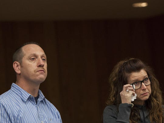 Tony Myers and Kristen Myers-Chatman react as their