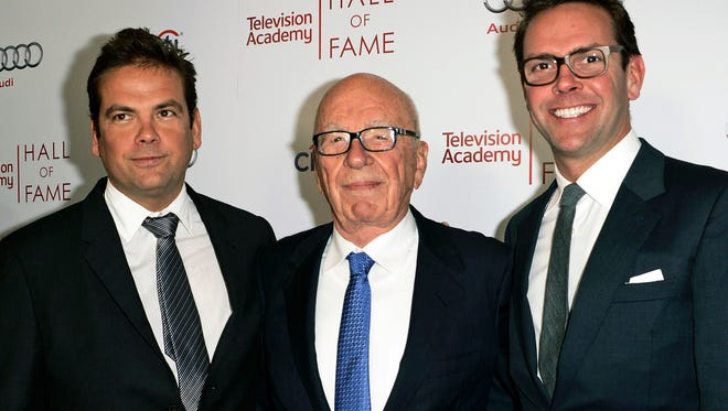 In this March 11, 2014 file photo, News Corp. Exeuctive Chairman Rupert Murdoch, center, and his sons, Lachlan, left, and James Murdoch attend the 2014 Television Academy Hall of Fame in Beverly Hills, Calif.