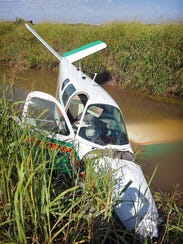 A 1955 Beechcraft Bonanza lies partially submerged