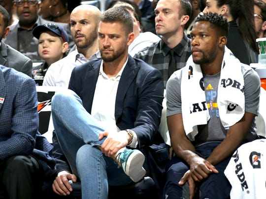 Grizzlies forward Chandler Parsons, left, sits on the bench in street clothes next to Toney Douglas during a game against the Bucks last season. Parsons was shut down for the season after being diagnosed with a partial tear of the meniscus in his left knee.