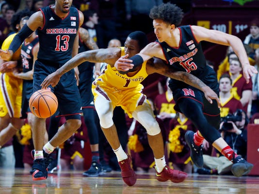 Minnesota's Dupree McBrayer, left, and Nebraska's Isaiah Roby chase a loose ball in the first half of an NCAA college basketball game Tuesday, Feb. 6, 2018, in Minneapolis. (AP Photo/Jim Mone)