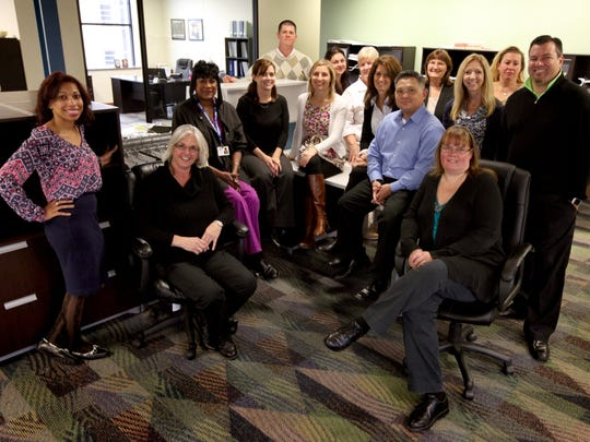 Custom Home Health employees gather at their office