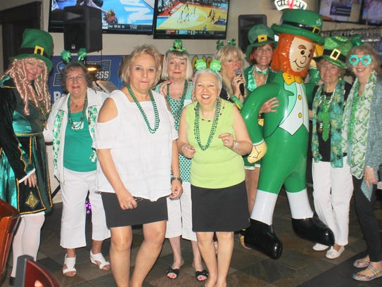 Paddy the inflatable leprechaun, dances with the lassies.