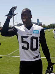 Jacksonville Jaguars linebacker Telvin Smith (50) gestures towards fans after rookie minicamp at Florida Blue Health and Wellness Practice Fields.
