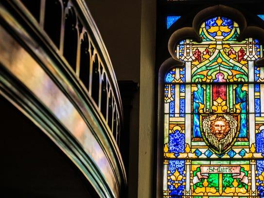 A Tiffany stained glass window is seen inside the Reid
