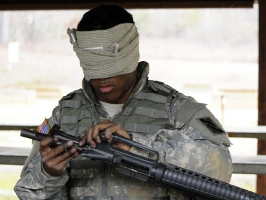 U.S. Army Spc. Jason J. Hulse of Augusta, Ga., a maintenance specialist with.jpg