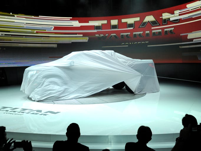 A sheet is pulled off the Nissan Titan Warrior Concept.