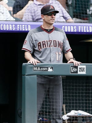 Jul 12, 2018: Arizona Diamondbacks manager Torey Lovullo (17) looks on in the fifth inning against the Colorado Rockies at Coors Field.