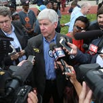 Michigan Governor Rick Snyder talks with reporters about the old Southwestern high school being turned into a manufacturing facility run by Sakthi that will provide over 600 jobs to the area on Monday, May 11,2015 in SW Detroit.