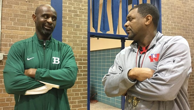 Bossier coach Jeremiah Williams (left) and Woodlawn coach Kenny Sykes talk basketball during a game recently.