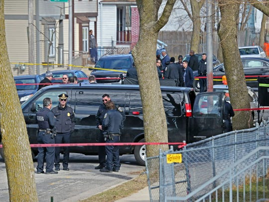 Police investigate the shooting death of a City of