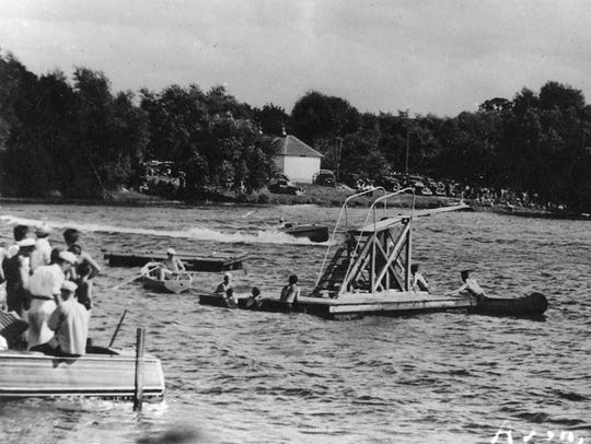Swimmers use the old raft at Avon Beach on Middle Spunk