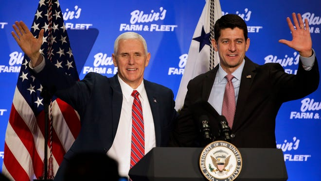 Vice President Mike Pence (left) and Speaker of the House Paul Ryan greet over 200 employees at Blain's Fleet and Farm Distribution Center in Janesville, Friday, March 3, 2017, during a listening session with Wisconsin business leaders.