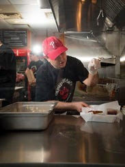 Cajun Kate's co-owner Don Applebaum preps meals at